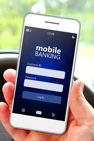 銀行のログイン ページ車の中で携帯電話を持つ手 写真素材