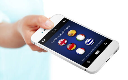 linguistics: hand holding mobile phone with language learning application over white background