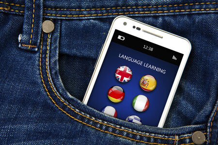 lingua: closeup of mobile phone with language learning application in jeans pocket. focus on screen Stock Photo
