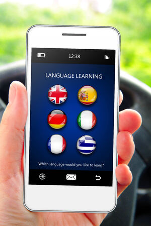 lingua: hand holding mobile phone with language learning application in the car Stock Photo