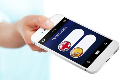 linguistics: mobile phone with language translator application over white background