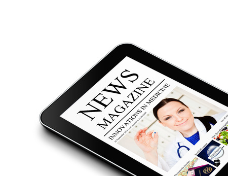 tablet with nwes magazine page isolated over white background photo