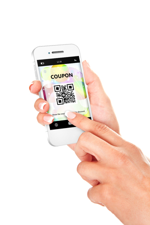 hand holding mobile phone with discount coupon isolated over white background photo