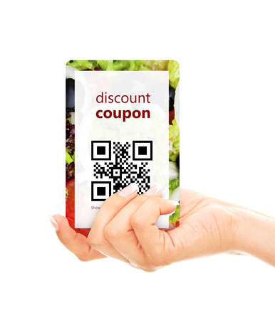 hand holding food discount coupon with qr code isolated over white  photo