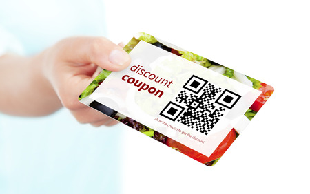 hand holding food discount coupon with qr code isolated over white  Archivio Fotografico