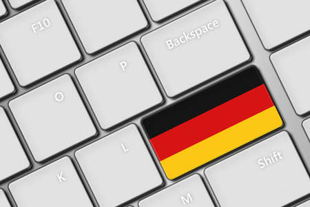 closeup of computer keyboard with german flag button photo
