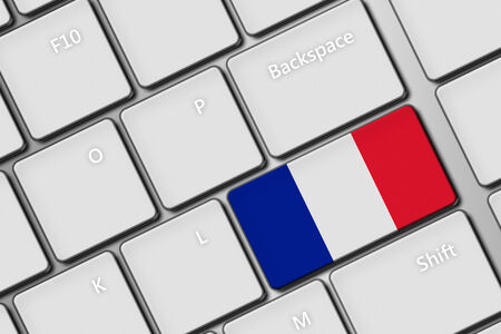 closeup of computer keyboard with France flag button photo