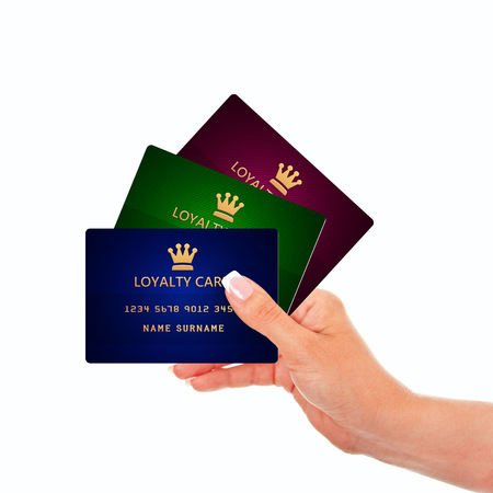 hand holding loyalty cards isolated over white background Stock Photo