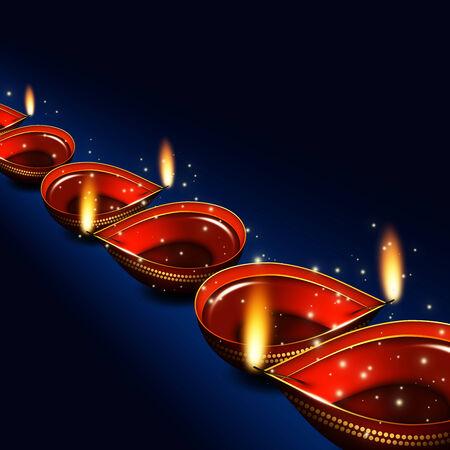 candil: lámparas de aceite Diwali sobre fondo azul oscuro con lugar para el texto