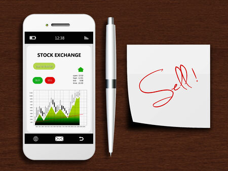 mobile phone with stock exchange screen, pen and sell note lying on wooden desk photo