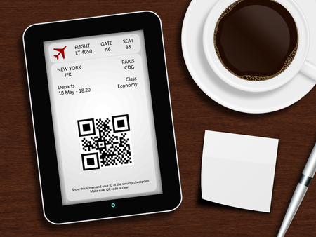 tablet with boarding pass, mug of coffee, pen and white blank lying on wooden desk photo