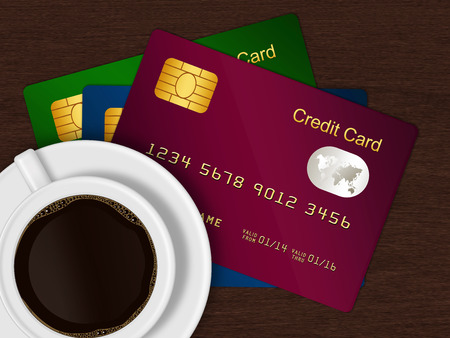 debet: white cup of coffee with credit cards lying on wooden desk Stock Photo