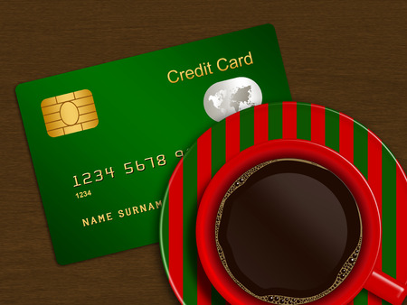 debet: christmas cup of coffee with credit card lying on wooden desk