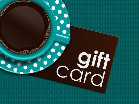 discount card: cup of coffee with gift card lying on tablecloth
