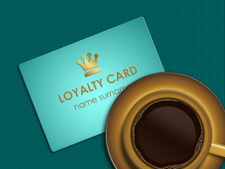 discount card: cup of coffee with loyalty card lying on tablecloth Stock Photo