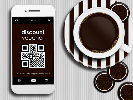 mobile phone with discount coupon, cup of coffee and gingerbread lying on white tablecloth