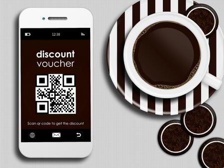 mobiele telefoon met kortingsbon, kopje koffie en koek liggend op wit tafelkleed
