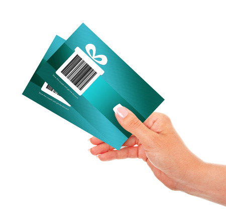 hand holding discount coupons isolated over white background. focus on coupons