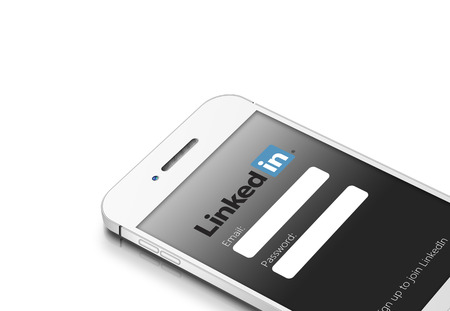 Gdansk, Poland - March 2, 2015: white mobile phone with linkedin social network isolated over white background