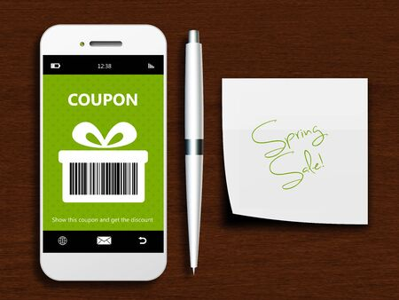 green coupon: mobile phone with spring discount coupon and note lying on wooden table