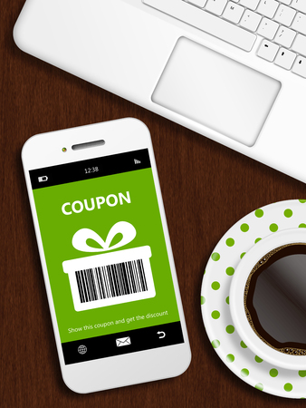 mobile phone: mobile phone with spring discount coupon, laptop and cup of coffee over wooden desk