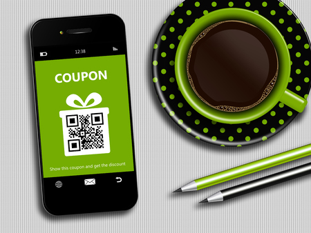 mobile phone with spring discount coupon, coffee and office tools lying on desk