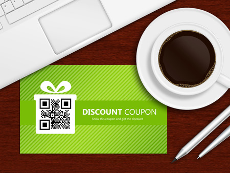 spring discount coupons with laptop and office tools lying on wooden table