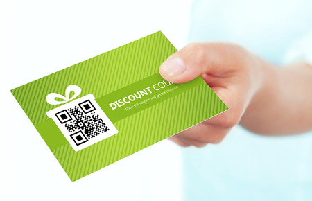 discount coupon: hand holding spring discount card isolated over white background Stock Photo