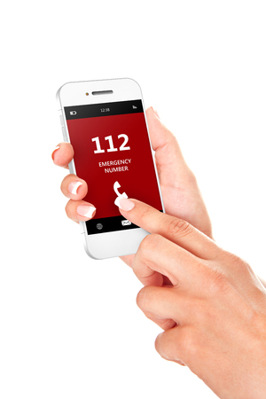 emergency number: hand holding mobile phone with emergency number 112 isolated over white background