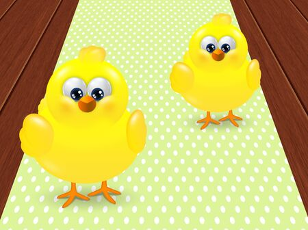 passover and easter chick: two easter chicks standing on dotted tablecloth with place for text Stock Photo