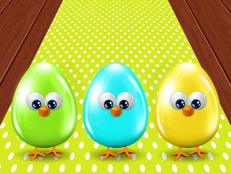 passover and easter chick: three colored Easter eggs standing on wooden floor with tablecloth Stock Photo