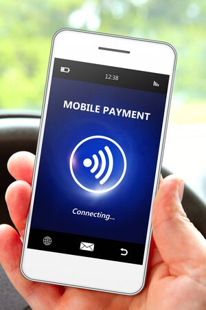 non cash: hand holding mobile phone with mobile payment. focus on phone