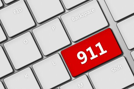 emergency services occupation: closeup of computer keyboard with emergency number 911 Stock Photo