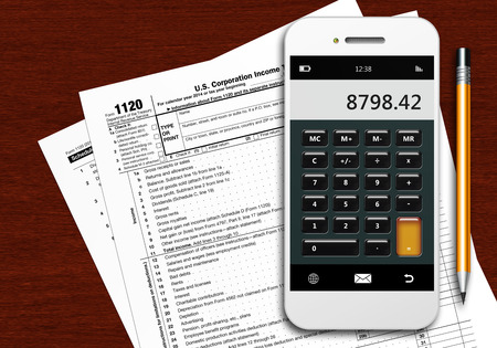 tax form: tax form 1120 with phone calculator and pencil lying on wooden table Stock Photo