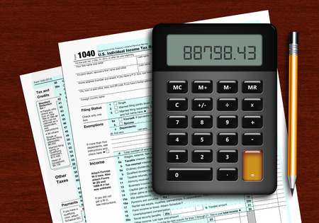 tax return: u.s. individual income tax return form 1040 with calculator and pencil lying on wooden table Stock Photo
