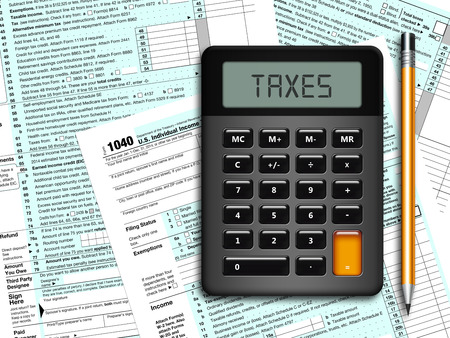 u.s. individual income tax return form 1040 with calculator and pencil lying on table