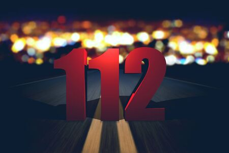 emergency number: 112 emergency number standing on the road by night