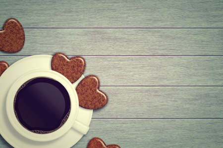 valentine day cup of coffee: mug of coffee with heart cookies lying on wooden table with place for text Stock Photo