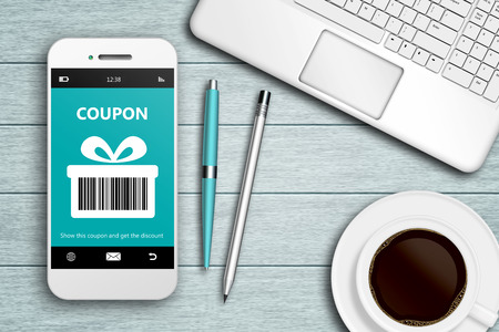 mobile phone with discount coupon, computer and coffee