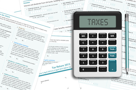 UK tax form with calculator lying on wooden desk with place for text