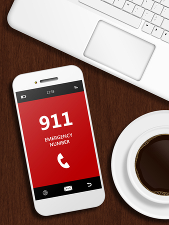 emergency number: mobile phone with 911 emergency number lying on wooden desk
