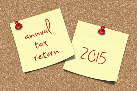 pin board: two notes with annual tax return text pinned to pin board Stock Photo