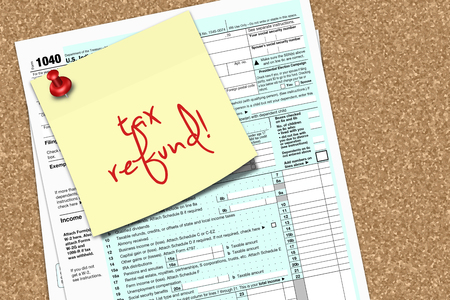 pin board: note with tax refund text and 1040 tax form pinned to pin board