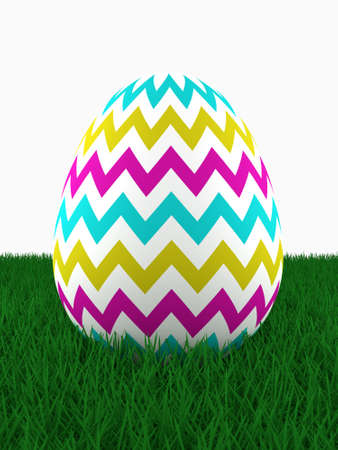 lying: easter colored egg lying on grass with place for text Stock Photo