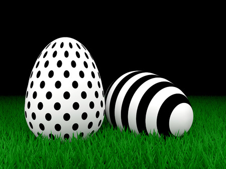 lying in: two Easter eggs lying in grass over dark background