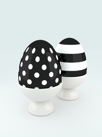festive occasions: pair of black and white 3d Easter eggs Stock Photo