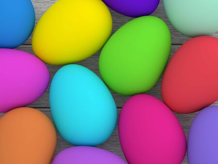 wooden desk: colored Easter eggs lying on wooden desk Stock Photo
