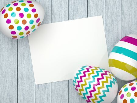 limon: colored Easter eggs lying on wooden desk with empty stick note