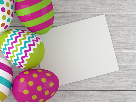 stick note: colored Easter eggs lying on wooden desk with empty stick note