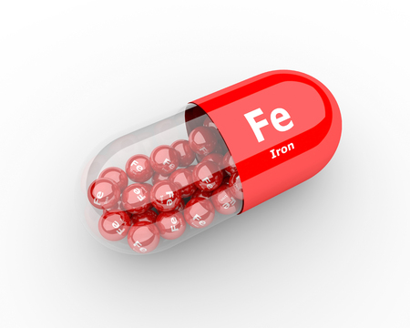 3d pills with iron Fe element dietary supplements 写真素材
